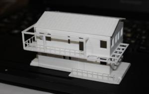 Макет дома в уменьшенном масштабе по чертежам.